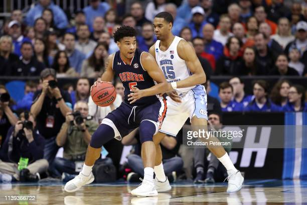 Chuma Okeke of the Auburn Tigers handles the ball against Garrison Brooks of the North Carolina Tar Heels during the 2019 NCAA Basketball Tournament...