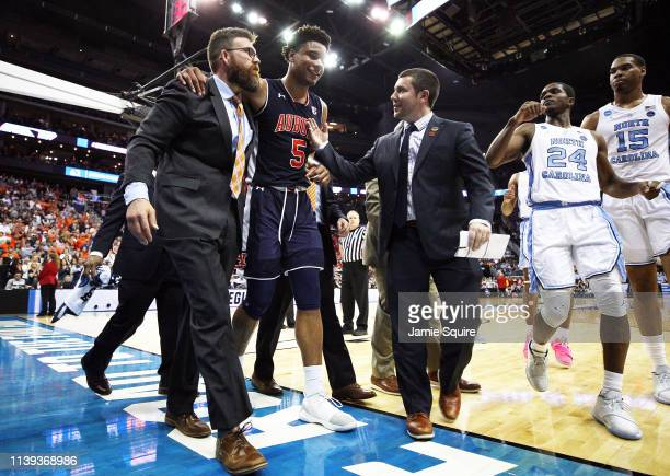 Chuma Okeke of the Auburn Tigers is helped off the court after suffering an injury against the North Carolina Tar Heels during the 2019 NCAA...