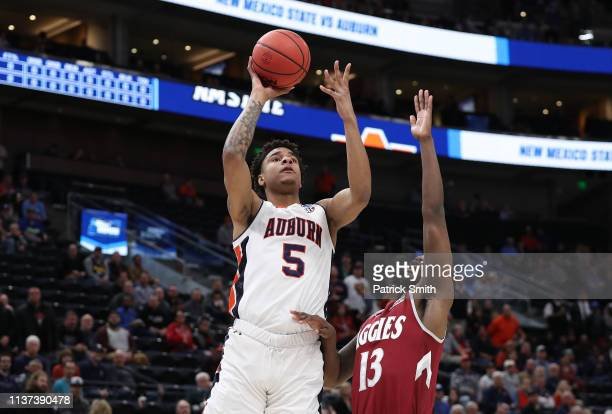 Chuma Okeke of the Auburn Tigers shoots the ball against CJ Bobbitt of the New Mexico State Aggies during the first half in the first round of the...
