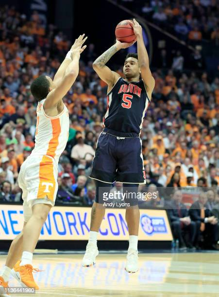 Chuma Okeke of the Auburn Tigers shoots the ball during the 8464 win against the Tennessee Volunteers during the final of the SEC Basketball...