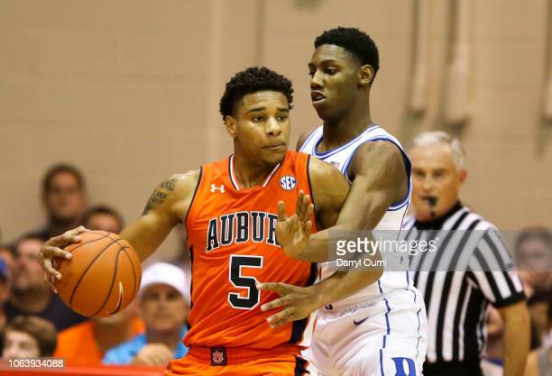Chuma Okeke of the Auburn Tigers tries to dribble past RJ Barrett of the Duke Blue Devils during the first half of the game at the Lahaina Civic...