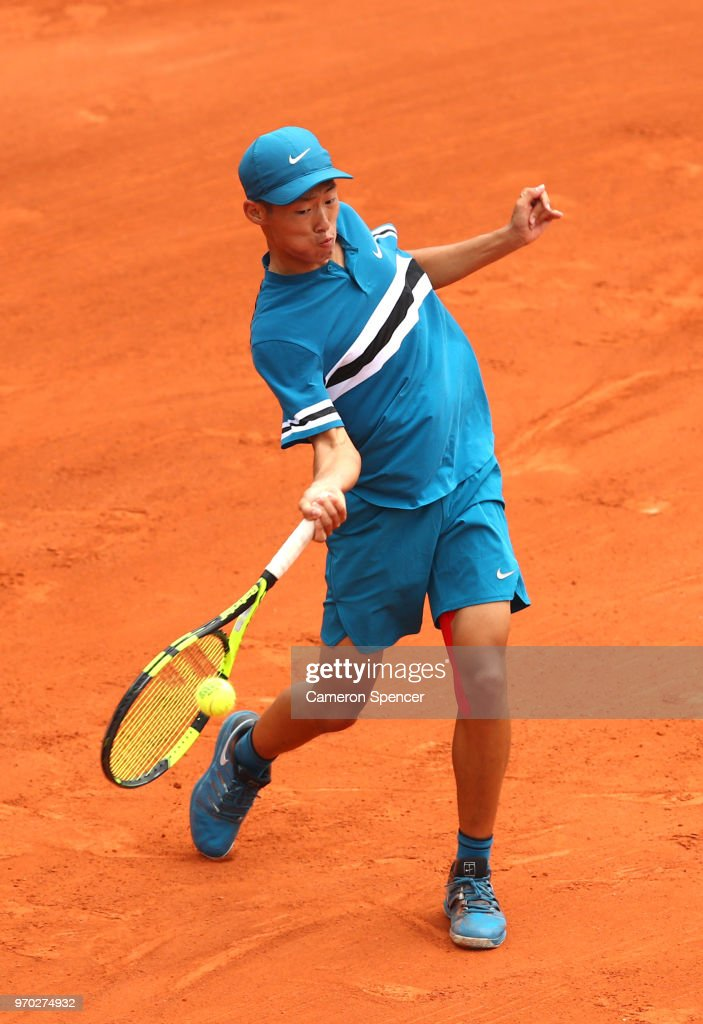 Chun Hsin Tseng of Chinese Taipei returns the ball during his boys singles final against Sebastian Baez of Argentina during day fourteen of the 2018 French Open at Roland Garros on June 9, 2018 in Paris, France.