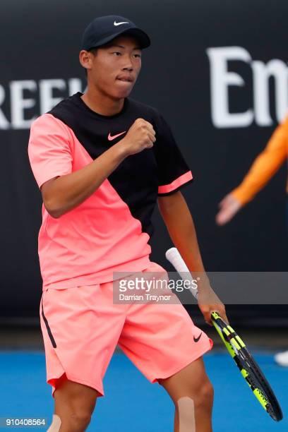 Chun Hsin Tseng of Taipei celebrates winning a point against Aidan McHugh of Great Britain in the boys' singles semifinal during the Australian Open...