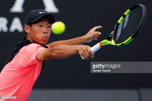 Chun Hsin Tseng of Taipei plays a backhand against Aidan McHugh of Great Britain in the boys' singles semifinal during the Australian Open 2018...