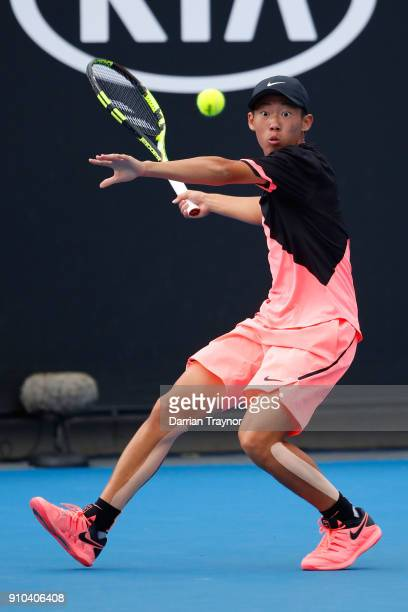 Chun Hsin Tseng of Taipei plays a forehand against Aidan McHugh of Great Britain in the boys' singles semifinal during the Australian Open 2018...