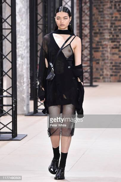Chun Jin walks the runway during the Ann Demeulemeester Womenswear Spring/Summer 2020 show as part of Paris Fashion Week on September 26, 2019 in...