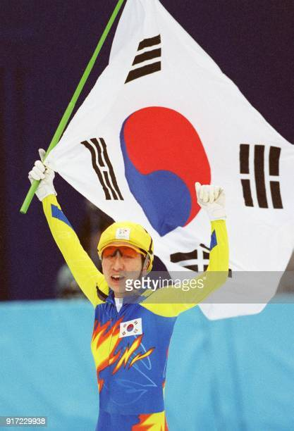 Chun LeeKyung of South Korea carries the Korean flag as she skates a lap of honour around the White Ring rink in Nagano after winning the gold medal...