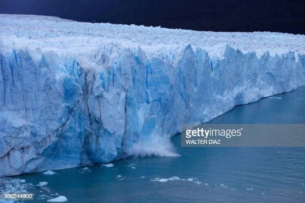 Chunck of ice falls from the Perito Moreno Glacier, at Los Glaciares National Park, near El Calafate in the Argentine province of Santa Cruz, on...