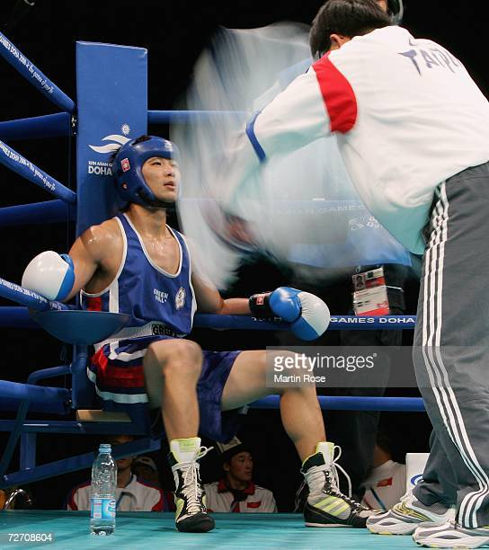 Chung Chun An of Chinese Taipei receives attention in his corner during their feather 57kg Men's Boxing Qualification bout at the 15th Asian Games...