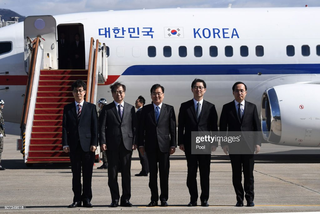 Chung Eui-Yong (C), head of the presidential National Security Office, Suh Hoon (2nd L), the chief of the South's National Intelligence Service, and other delegators pose before boarding an aircraft as they leave for Pyongyang at a military airport on March 5, 2018 in Seongnam, South Korea. South Korean envoys are to visit North Korea for two days to discuss issues.