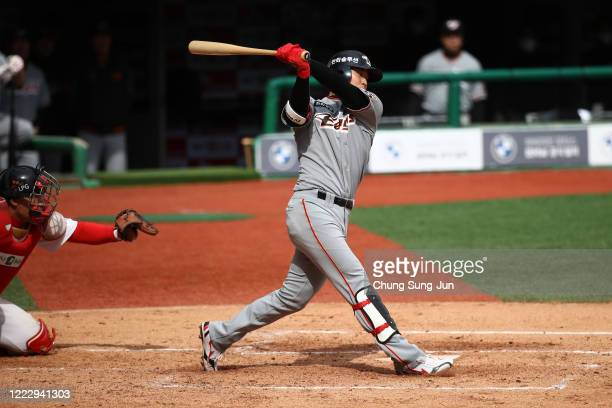 Chung Eunwon of Hanwha Eagles bats during the Korean Baseball Organization League opening game between SK Wyverns and Hanwha Eagles at the empty SK...