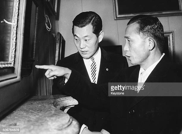 Chung Hee Park President of South Korea points to a painting of Castle Schleissheim as his interpreter looks on Germany circa 1965