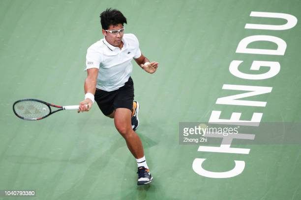Chung Hyeon of Korea returns a shot against Felix Auger-Aliassime of Canada during 2018 ATP World Tour Chengdu Open at Sichuan International Tennis...