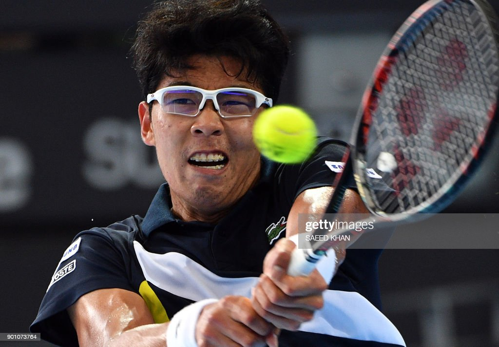 Chung Hyeon of South Korea hits a return against Kyle Edmund of Britain during their men's singles second round match at the Brisbane International tennis tournament at the Pat Rafter Arena in Brisbane on January 4, 2018. /