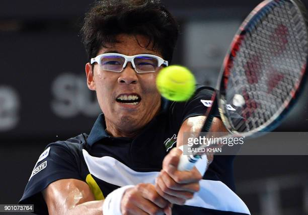 Chung Hyeon of South Korea hits a return against Kyle Edmund of Britain during their men's singles second round match at the Brisbane International...
