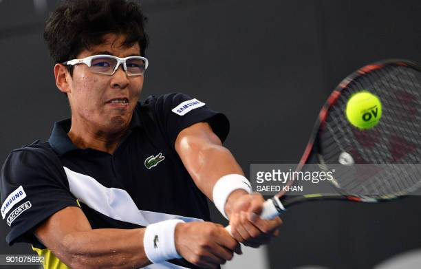Chung Hyeon of South Korea hits a return against Kyle Edmund of Britain during their men's singles second round match at Pat Rafter Arena during the...