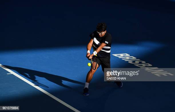 TOPSHOT Chung Hyeon of South Korea hits a return against Kyle Edmund of Britain during their men's singles second round match at Pat Rafter Arena...