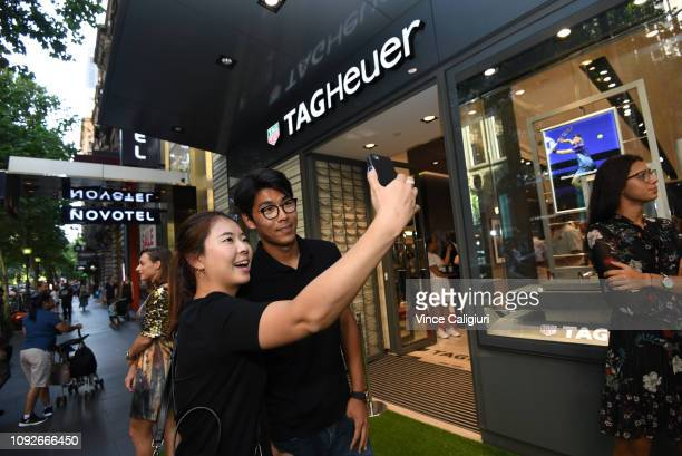 Chung Hyeon of South Korea poses with a fan at the Unveiling of Tag Heuer's Global Tennis Ambassadors at the Tag Heuer Boutique on January 11, 2019...