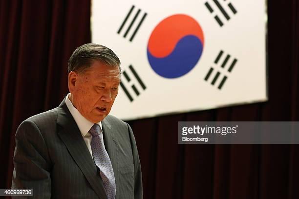Chung Mong Koo chairman and chief executive officer of Hyundai Motor Co and Kia Motors Corp walks beneath the South Korean national flag during a new...