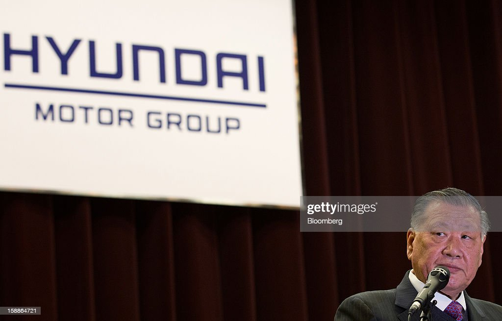 Chung Mong Koo, chairman of Hyundai Motor Co. and Kia Motors Corp., pauses during a new year company meeting in Seoul, South Korea, on Wednesday, Jan. 2, 2013. Hyundai Motor and smaller affiliate Kia Motors, South Korea's two largest automakers, forecast their slowest sales growth in seven years as a slowing global economy and strengthening won saps demand. Photographer: SeongJoon Cho/Bloomberg via Getty Images
