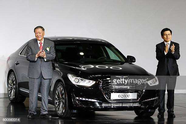 Chung Mong Koo chairman of Hyundai Motor Co and Kia Motors Corp left and Hwang Kyo Ahn South Korea's prime minister stand next to a Hyundai Motor Co...