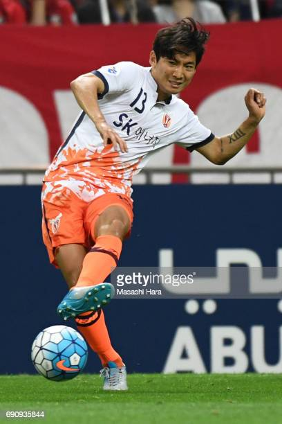 Chung Woon of Jeju United FC in action during the AFC Champions League Round of 16 match between Urawa Red Diamonds and Jeju United FC at Saitama...