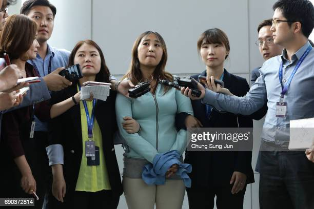 Chung Yoora the 21yearold daughter of Choi Soonsil answers questions fom the press after arriving at the Incheon International Airport on May 31 2017...
