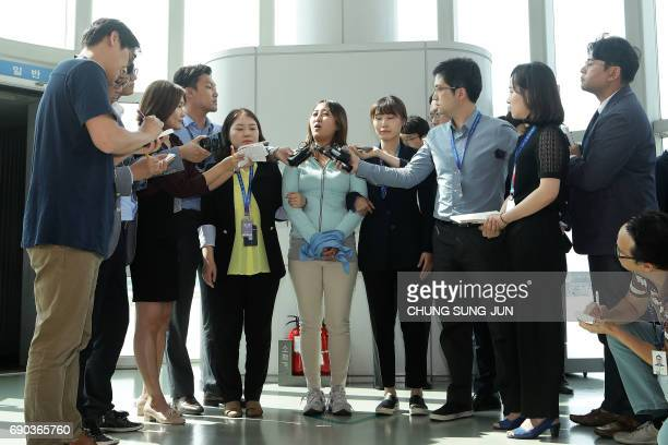 Chung YooRa the daughter of Choi Soonsil the close confidante of impeached expresident Park GeunHye answers questions from the press after arriving...