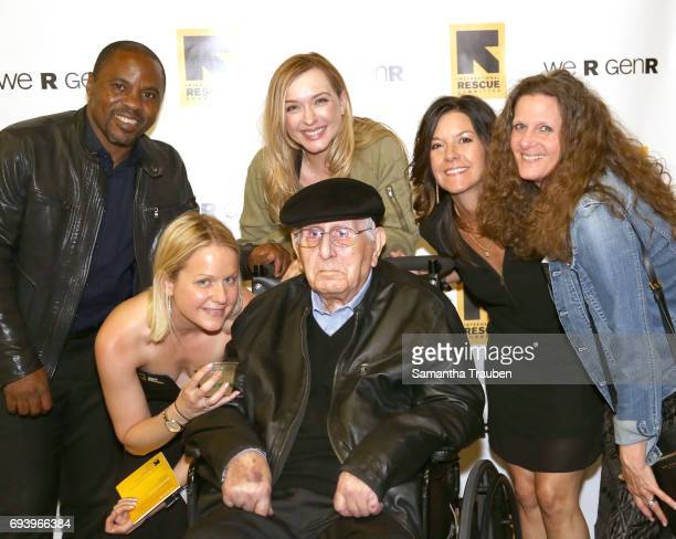 Chungong Melvin Azefor Samantha Becker Arnold Spielberg Shelley Bennett Stacy Meyer and Michelle Fandetti attend Uprooted Heroes Portraits of...