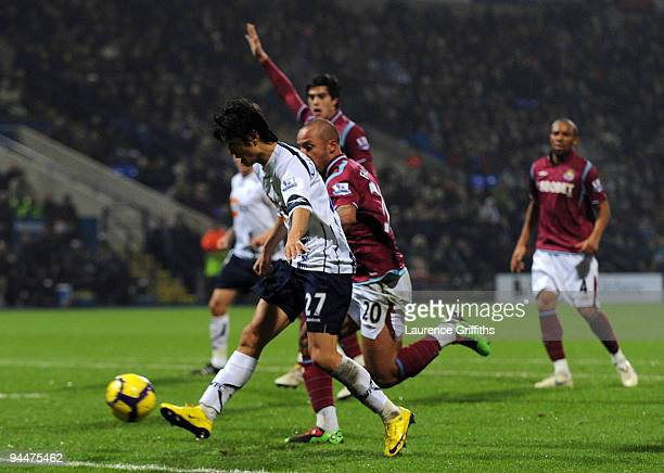 Chung-Yong Lee of Bolton scores the first goal during the Barclays Premier League match between Bolton Wanderers and West Ham United at The Reebok...