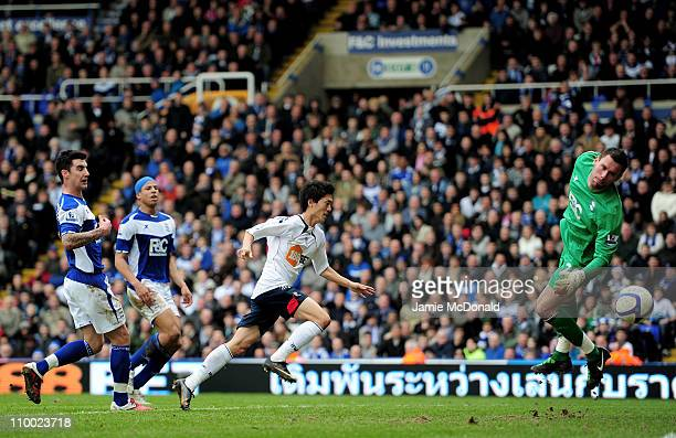 ChungYong Lee of Bolton Wanderers scores their third and the winning goal past Ben Foster of Birmingham City during the FA Cup sponsored by EOn Sixth...