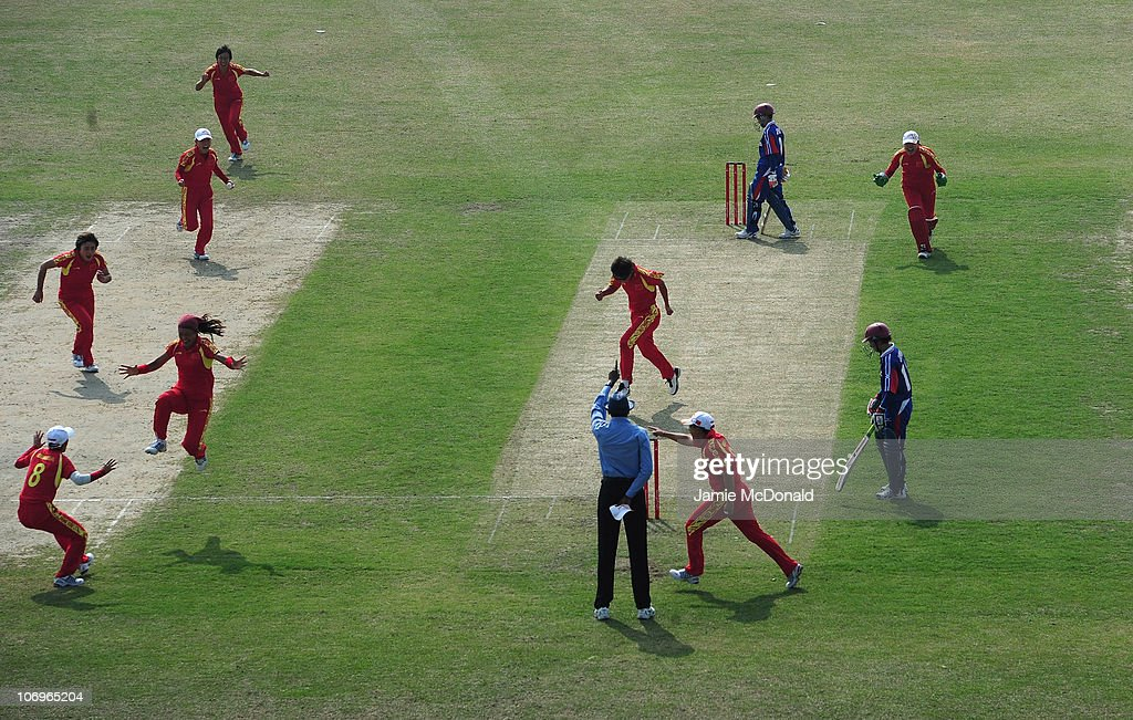 Chunhua Mei of Cina celebrates a wicket during the Woman's Bronze Medal match between Japan and China at Guanggong Cricket Stadium during day seven of the 16th Asian Games Guangzhou 2010 on November 19, 2010 in Guangzhou, China.