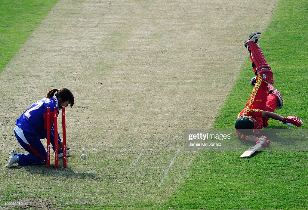 Chunhua Mei of Cina is run out during the Woman's Bronze Medal match between Japan and China at Guanggong Cricket Stadium during day seven of the 16th Asian Games Guangzhou 2010 on November 19, 2010 in Guangzhou, China.