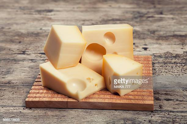 chunks of maasdam dutch cow's milk cheese - cheese stock pictures, royalty-free photos & images