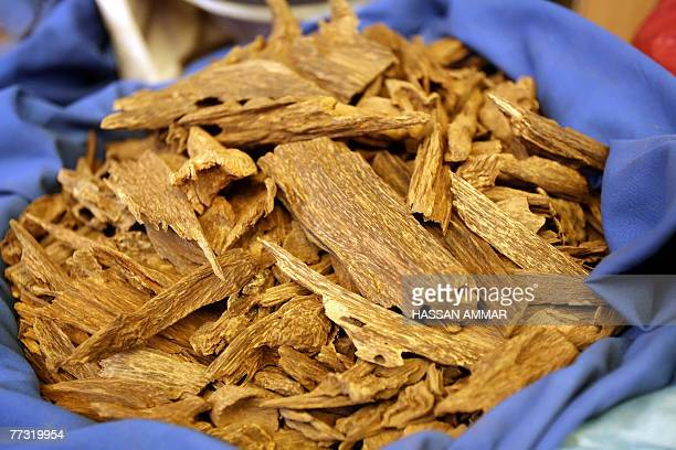 Chunks of Oud or Agarwood lie in a sack at a shop in Riyadh 10 October 2007 Oud also known by the names Agrawood and Aloeswood is the resinous...