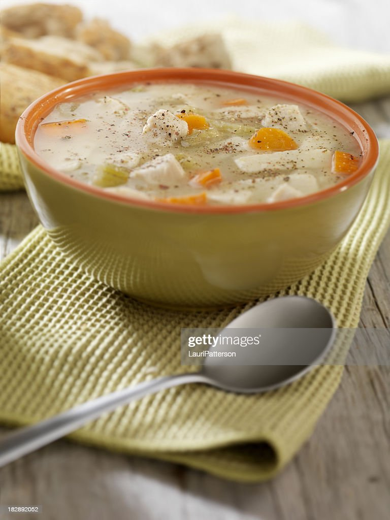Chunky Chicken Noodle Soup with Crusty Bread : Stock Photo