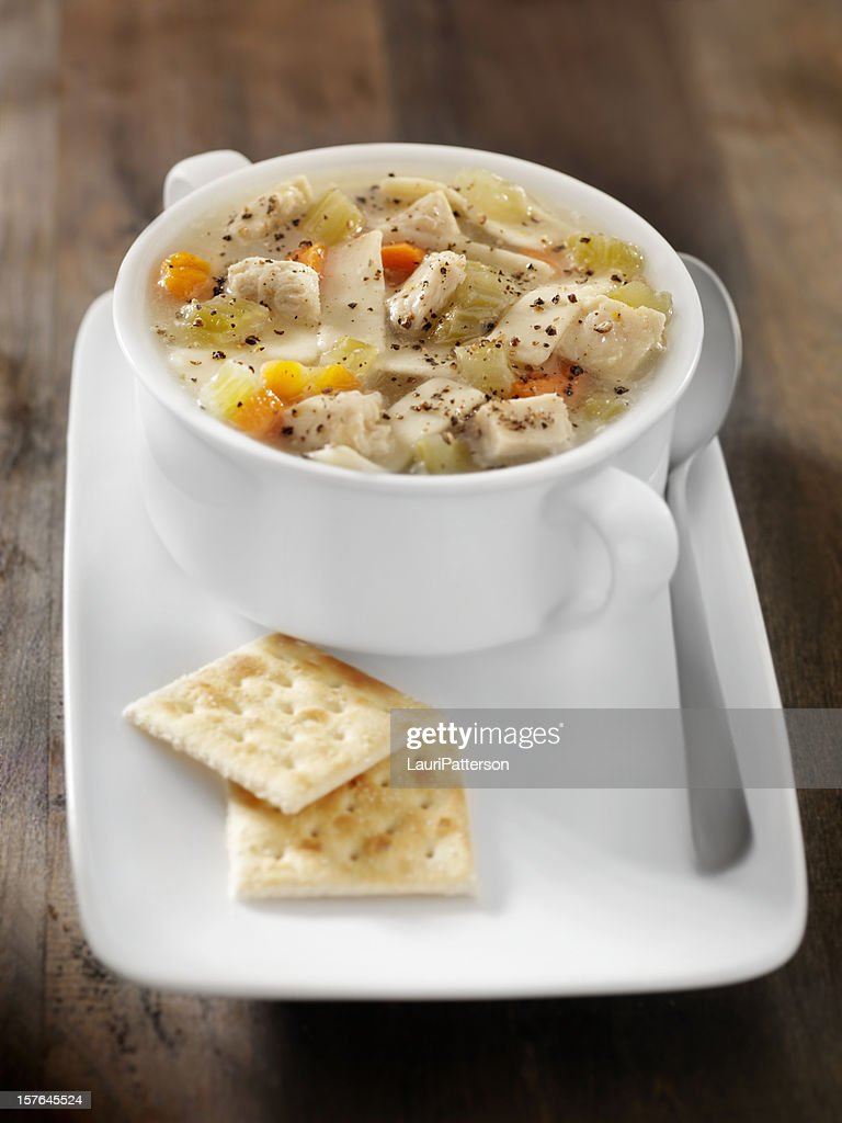 Chunky Chicken Noodle Soup with Saltine Crackers : Stock Photo