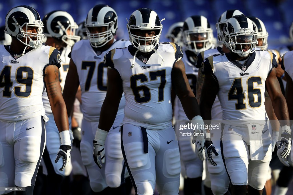 Chunky Clements #67 of the Los Angeles Rams and teammates take the field for warmups before playing against the Baltimore Ravens during a preseason game at M&T Bank Stadium on August 9, 2018 in Baltimore, Maryland.