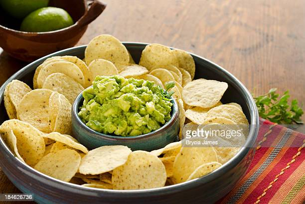 chunky guacamole and corn chips horizontal - guacamole stock photos and pictures