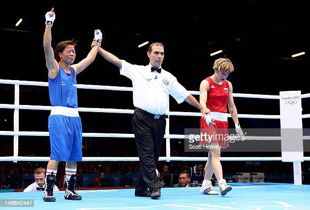 Chunneijang Mery Kom Hmangte of India celebrates her victory Karolina Michalczuk of Poland during the Women's Fly Boxing on Day 9 of the London 2012...