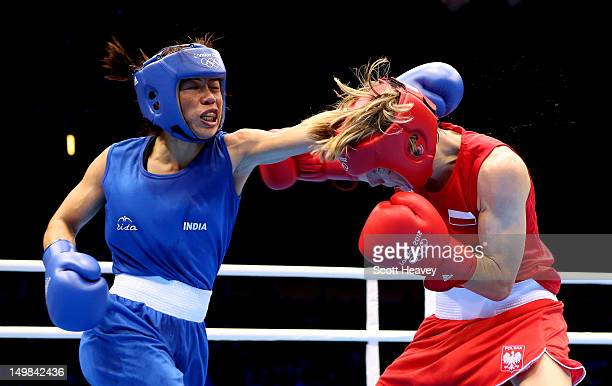 Chunneijang Mery Kom Hmangte of India in action with Karolina Michalczuk of Poland during the Women's Fly Boxing on Day 9 of the London 2012 Olympic...