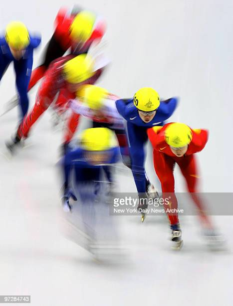 ChunSa Byun of Korea and a pack of other speed skaters are a blur as they whiz around the rink during the women's 1500meter short track finals at the...