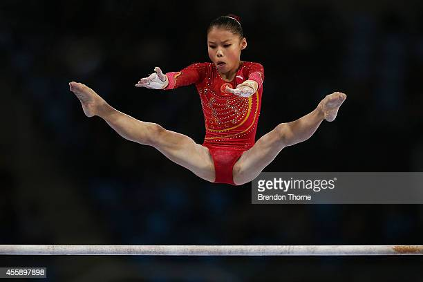 Chunsong Shang of China competes in the Qualifying round of the Women's Uneven Bars during day three of the 2014 Asian Games at the Namdong Gymnasium...