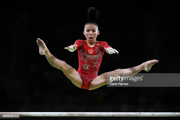 Chunsong Shang of China competes on the uneven bars during Women's qualification for Artistic Gymnastics on Day 2 of the Rio 2016 Olympic Games at...