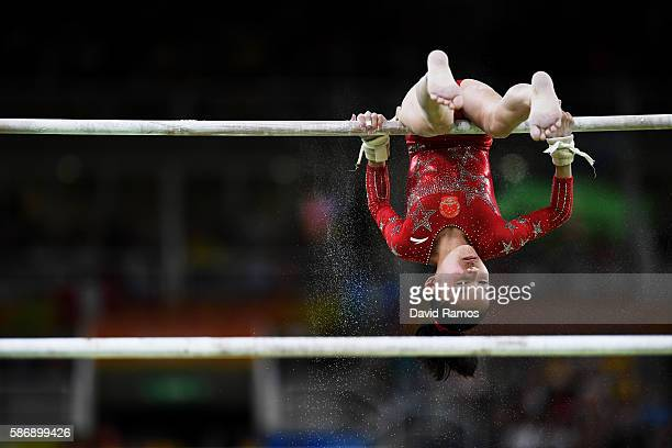 Chunsong Shang of China competes on uneven bars during Women's qualification for Artistic Gymnastics on Day 2 of the Rio 2016 Olympic Games at the...