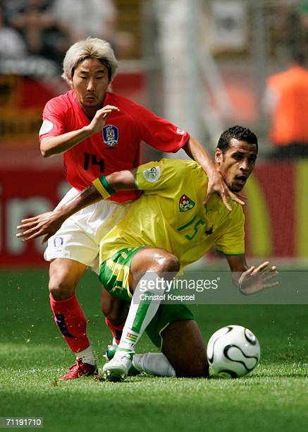 ChunSoo Lee of South Korea and Alaixys Romao of Togo battle for the ball during the FIFA World Cup Germany 2006 Group G match between South Korea and...