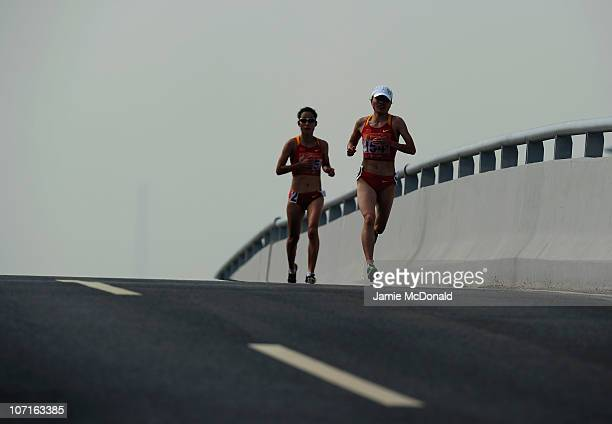 Chunxiu Zhou of China picks up the pace during the Wonen's Marathon at Triathlon Venue during day fifteen of the 16th Asian Games Guangzhou 2010 on...