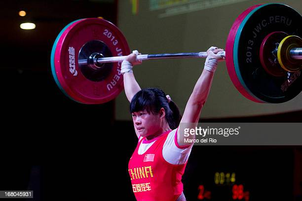 Chunying Guan of China A competes in the Women's 48kg clean and jerk during day one of the 2013 Junior Weightlifting World Championship at Maria...