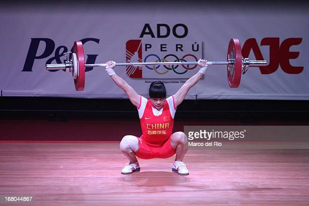 Chunying Guan of China A competes in the Women's 48kg snatch during day one of the 2013 Junior Weightlifting World Championship at Maria Angola...