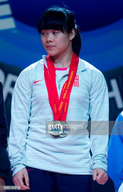 Chunying Guan of China A receives three golden medals during the Women's 48kg podium on day one of the 2013 Junior Weightlifting World Championship...